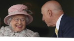 Queen Elizabeth II speaks with an unidentified man at an event at Newbury Racecourse in Newbury England Friday, April 21, 2017. (Andrew Matthews/PA via AP)