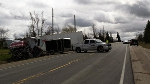 A transport truck rolled over into a ditch off of Highway 6 north of Arthur, leaving its driver in critical condition, on Friday, April 21, 2017. (Marta Czurylowicz / CTV Kitchener)