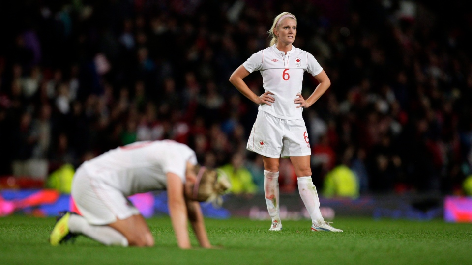 Canada's Kaylyn Kyle, right, reacts after her team's 4-3 loss to the United States in their semifinal women's soccer match at the 2012 London Summer Olympics, on Aug. 6, 2012 at Old Trafford Stadium in Manchester, England. THE CANADIAN PRESS/AP, Jon Super