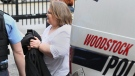 Elizabeth Wettlaufer is escorted into the courthouse in Woodstock, Ont., on Friday, April 21, 2017. (Dave Chidley/The Canadian Press)