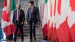Prime Minister Justin Trudeau, right, walks with Italian Prime Minister Paolo Gentiloni as they arrive for a press conference during a working visit in Ottawa on Friday, April 21, 2017. THE CANADIAN PRESS/Justin Tang