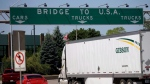 Traffic makes its way to Ambassador Bridge that connects Canada to the United States Windsor Ont. on Friday June 15, 2012. (THE CANADIAN PRESS/Mark Spowart)