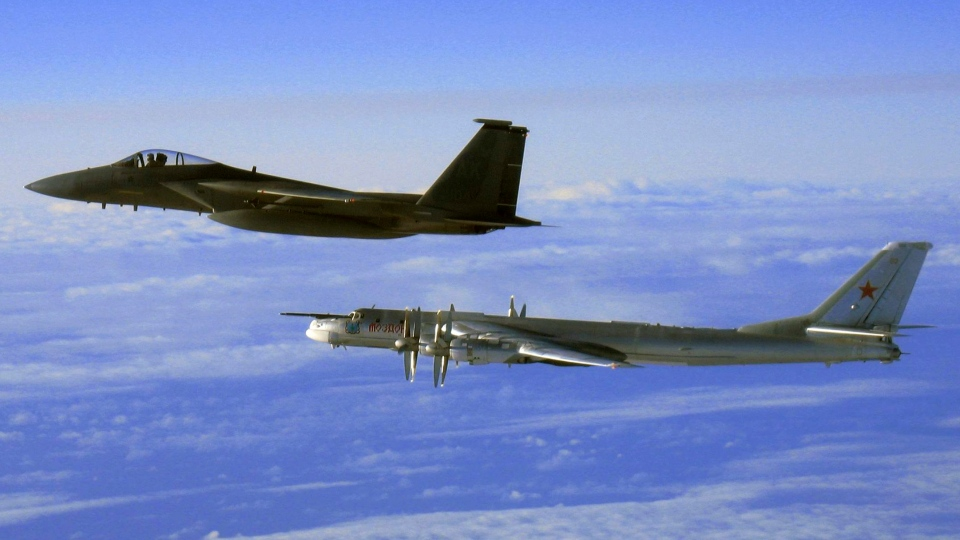This Thursday, Sept. 28, 2006 file photo provided by the U.S. Air Force shows an F-15C Eagle from the 12th Fighter Squadron at Elmendorf Air Force Base in Anchorage, Alaska, flying next to a Russian Tu-95 'Bear' bomber, right, during a Russian exercise which brought the bomber near the west coast of Alaska. (AP Photo / U.S. Air Force)