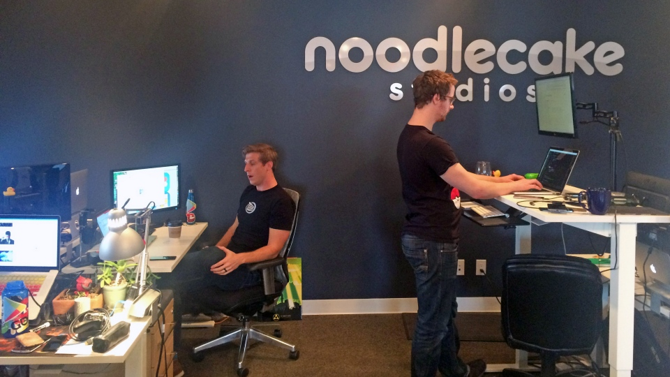 Two members of the Noodlecake Studios team work in the company's office in Saskatoon on Friday, April 21, 2017. (Laura Woodward/CTV Saskatoon)