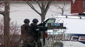 Guelph Police officers are seen outside a home on Buckthorn Crescent on Friday, April 21, 2017.