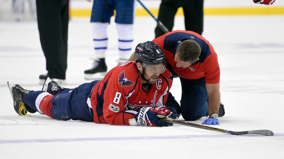 Washington Capitals left wing Alex Ovechkin (8), of Russia, is tended to by a trainer after being injured during the first period of Game 5 in an NHL Stanley Cup hockey first-round playoff series against the Toronto Maple Leafs, in Washington, on Friday, April 21, 2017. (AP Photo/Nick Wass)