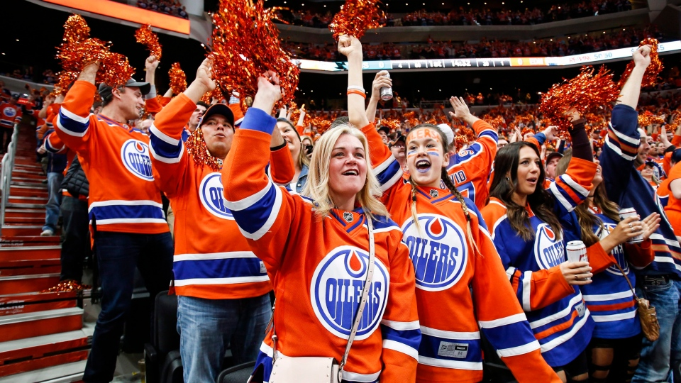 Edmonton Oilers' fans cheer the team's goal during first period NHL hockey round one playoff action against the San Jose Sharks in Edmonton, Thursday, April 20, 2017. (THE CANADIAN PRESS/Jeff McIntosh)