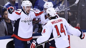 Washington Capitals centre Evgeny Kuznetsov (92) celebrates his goal against the Toronto Maple Leafs with Capitals centre Marcus Johansson (90) and Capitals right wing Justin Williams (14) during second period NHL hockey round one playoff action in Toronto on Monday, April 17, 2017. (THE CANADIAN PRESS/Frank Gunn)