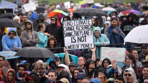 "A person hold up a sign that reads ""Fund Climate Change Research Saving The Planet Is Not A Waste Of Money"" during the March for Science in Washington, Saturday, April 22, 2017. Thousands of scientists worldwide left their labs to take to the streets Saturday along with students and research advocates in pushing back against what they say are mounting attacks on science. (AP Photo/Sait Serkan Gurbuz)"
