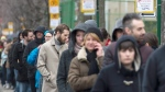 French expats wait in line to vote in Montreal, Saturday, April 22, 2017. France goes to the polls on Sunday, April 23, for the first round of the 2017 French presidential election. lTHE CANADIAN PRESS/Graham Hughes