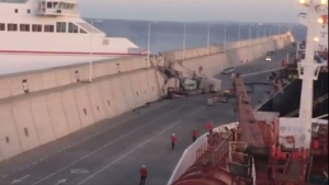 This image taken from video shows a Naviera Armas ferry after hitting the breakwater at Puerta de la Luz, Gran Canaria, Spain on Friday, April 21, 2017. (EMERGCAN via AP)