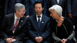 From left, German Federal Minister of Finance Wolfgang Schauble, Zhou Xiaochuan, Governor of the People's Bank of China, Chinese Finance Minister Xiao Jie and International Monetary Fund Managing Director Christine Lagarde gather for the Family Photo during the G20 at the 2017 World Bank Group Spring Meetings in Washington, Friday, April 21, 2017. (AP Photo / Carolyn Kaster)