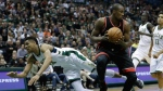 Milwaukee Bucks' Giannis Antetokounmpo falls after fouling Toronto Raptors' Serge Ibaka during the first half of Game 4 of an NBA first-round playoff series basketball game Saturday, April 22, 2017, in Milwaukee. (AP Photo/Morry Gash)