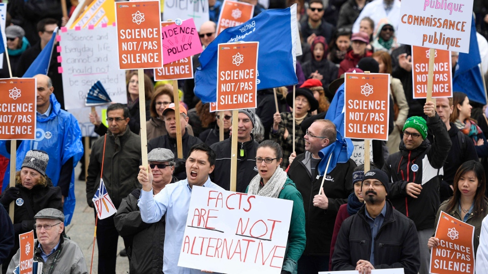 People participate in the March for Science on Parliament Hill in Ottawa, part of a global gathering to promote and advocate for science on Earth Day, Saturday, April 22, 2017. (THE CANADIAN PRESS / Justin Tang)