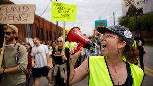 Patricia Bazemore shouts into a megaphone during the March for Science on Saturday, April 22, 2017, in Chattanooga, Tenn. About a thousand demonstrators marched from the Main Terrain Art Park to Riverfront Parkway and back in support of science and education in solidarity with other marches nationwide. (Doug Strickland/Chattanooga Times Free Press via AP)