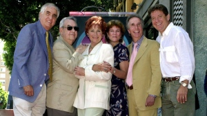 "In this July 12, 2001 file photo, Garry Marshall, from left, Tom Bosley, Marion Ross, Erin Moran, Henry Winkler, and Anson Williams of the television show ""Happy Days,"" pose after Ross received a star on the Hollywood Walk of Fame in the Hollywood section of Los Angeles. Moran, the former child star who played Joanie Cunningham in the sitcoms ""Happy Days"" and ""Joanie Loves Chachi,"" has died at age 56. (AP Photo / E.J. Flynn, File)"