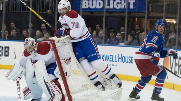 Montreal Canadiens defenseman Andrei Markov (79) flies onto the net and goalie Carey Price (31) after being checked by New York Rangers center J.T. Miller (10) during the second period of Game 6 of a first-round NHL hockey Stanley Cup playoff series, Saturday, April 22, 2017, at Madison Square Garden in New York. (AP Photo/Mary Altaffer)