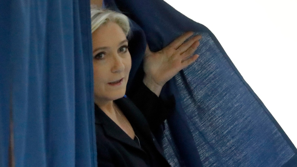 Far-right leader and candidate for the 2017 French presidential election Marine Le Pen exits a polling booth before voting for the first-round presidential election in Henin-Beaumont, northern France, Sunday, April 23, 2017. (AP / Frank Augstein)