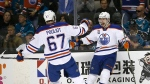 Edmonton Oilers left wing Anton Slepyshev (42) celebrates after scoring a goal with teammate Benoit Pouliot (67) during the second period against the San Jose Sharks in Game 6 of a first-round NHL hockey playoff series in San Jose, Calif., Saturday, April 22, 2017. (AP / Tony Avelar)
