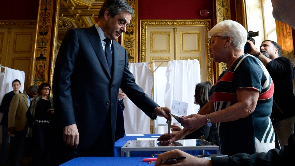 French conservative presidential election candidate Francois Fillon casts his ballot to vote in the first round of the presidential elections in Paris, Sunday, April 23, 2017. (Christophe Archambault, Pool via AP)