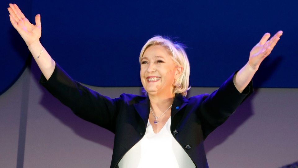 Far-right leader and candidate for the 2017 French presidential election, Marine Le Pen, cheers supporters on stage after exit poll results of the first round of the presidential election were announced at her election day headquarters in Henin-Beaumont, northern France on Sunday, April 23, 2017. (AP / Frank Augstein)