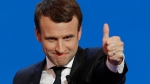 French centrist presidential candidate Emmanuel Macron thumbs up as he addresses his supporters at his election day headquarters in Paris , Sunday April 23, 2017. Macron and far-right populist Marine Le Pen advanced Sunday to a runoff in France's presidential election, remaking the country's political system and setting up a showdown over its participation in the European Union. (AP Photo/Christophe Ena)