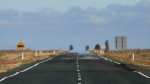 In this May 25, 2013 photo the Outback landscape is shown on the Sturt Highway near Wentworth, 1,043 kilometers from Sydney, Australia. (AP Photo/Rob Griffith)