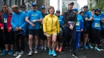 B.C. Liberal Leader Christy Clark, centre, waits to start the Sun Run in Vancouver, B.C., on Sunday April 23, 2017. A provincial election will be held on May 9. THE CANADIAN PRESS/Darryl Dyck