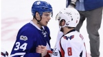 Toronto Maple Leafs centre Auston Matthews (34) and Washington Capitals left wing Alex Ovechkin (8) shake hands after the Washington Capitals defeated the Toronto Maple Leafs during the first overtime period of game six in an NHL Stanley Cup hockey first-round playoff series in Toronto on Sunday, April 23, 2017. THE CANADIAN PRESS/Frank Gunn