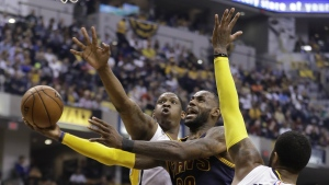 Cleveland Cavaliers' LeBron James shoots against Indiana Pacers' Kevin Seraphin and Paul George during the first half in Game 4 of a first-round NBA basketball playoff series in Indianapolis on Sunday, April 23, 2017. (AP / Darron Cummings)