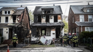 New York Fire Department personnel stand outside the scene of a deadly fire in Queens Village, New York that killed multiple people, including children on Sunday, April 23, 2017. (Michael Appleton / Office of the Mayor)