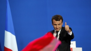 French centrist presidential candidate Emmanuel Macron thumbs up as he addresses his supporters at his election day headquarters in Paris on Sunday, April 23, 2017. (AP / Christophe Ena)
