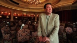 In this May 1999 photo, Sandy Gallin who was then chief of Mirage Entertainment and Sports, Inc. stands in the Bellagio Hotel in Las Vegas. (Gary Friedman/Los Angeles Times via AP)