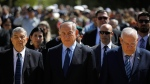 Israeli Prime Minister Benjamin Netanyahu, centre, President Reuven Rivlin, right, and the Chairman of the Yad Vashem, Avner Shalev at the Yad Vashem Holocaust memorial in Jerusalem, on April 24, 2017. (Amir Cohen / Pool Photo via AP)