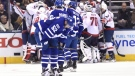 Toronto Maple Leafs centre Mitch Marner (16) centre Tyler Bozak (42) and defenceman Martin Marincin (52) look on as the Washington Capitals celebrate their win during the first overtime period of game six in an NHL Stanley Cup hockey first-round playoff series in Toronto on Sunday, April 23, 2017. (THE CANADIAN PRESS/Nathan Denette)