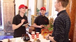Tim Hortons employees take orders at Canada House in London, Monday, April 24, 2017.