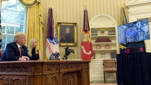 U.S. President Donald Trump, accompanied by his daughter Ivanka Trump, talks via video conference with International Space Station Commander Peggy Whitson and Jack Fischer on April 24, 2017. (Susan Walsh / AP)