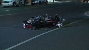 A motorcycle carrying a man and a teen girl lays on the roadway following a fail-to-remain collision.