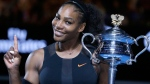 Serena Williams holds up a finger and her trophy after defeating her sister, Venus, in the women's singles final at the Australian Open tennis championships on Jan. 28, 2017. (Aaron Favila / AP)