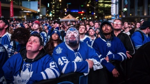 Fans watch during at a Playoff Tailgate Party in Maple Leaf Square during game six of the NHL Stanley Cup playoff series between the Toronto Maple Leafs and the Washington Capitals in Toronto on Sunday, April 23, 2017. THE CANADIAN PRESS/Aaron Vincent Elkaim