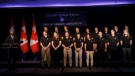 Navdeep Bains, left, Minister of Innovation, Science, and Economic Development introduces the top 17 candidates to be the next Canadian Space Agency astronaut, during a press conference in Toronto on April 24, 2017. (Cole Burston/The Canadian Press)