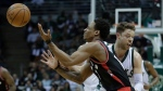 Milwaukee Bucks' Matthew Dellavedova fouls Toronto Raptors' DeMar DeRozan during the first half of Game 4 of an NBA first-round playoff series basketball game Saturday, April 22, 2017, in Milwaukee. (AP Photo/Morry Gash)