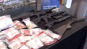 New Westminster Police display drugs and guns seized in an investigation, in New Westminster, B.C., on Monday, Apr. 24, 2017.