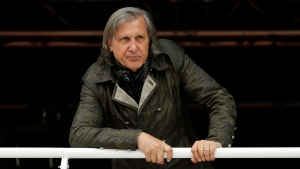 Former Romanian tennis ace Ilie Nastase watches a match of the French Open tennis tournament at the Roland Garros stadium, in Paris, France on Monday, May 23, 2016. (AP / Alastair Grant)