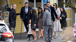 Shayanna Jenkins Hernandez, front, fiancee of former New England Patriots tight end Aaron Hernandez, arrives with their daughter Avielle Janelle Hernandez, Pittsburgh Steeler centre Maurkice Pouncey and his twin brother Mike, and others for a private service for Aaron Hernandez at O'Brien Funeral Home in Bristol, Conn. on Monday, April 24, 2017. (AP / Jessica Hill)
