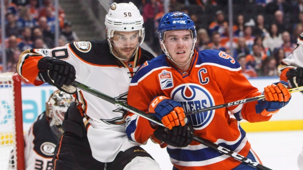 Anaheim Ducks' Antoine Vermette (50) and Edmonton Oilers' Connor McDavid (97) vie for position in front of the net during second period NHL action in Edmonton, Alta., on Saturday, April 1, 2017. (THE CANADIAN PRESS/Jason Franson)