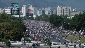 Opposition members stage a sit-in on a highway during a protest against President Nicolas Maduro in Caracas, Venezuela, Monday, April 24, 2017. (AP Photo/Fernando Llano)