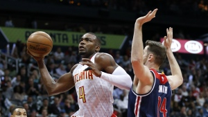 Atlanta Hawks forward Paul Millsap (4) goes in for a basket as Washington Wizards forward Jason Smith (14) defends during the first half in Game 4 of a first-round NBA basketball playoff series Monday, April 24, 2017, in Atlanta. (AP / John Bazemore)