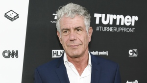 In this May 18, 2016 file photo, Anthony Bourdain attends the Turner Network 2016 Upfronts in New York. (Photo by Evan Agostini/Invision/AP, File)