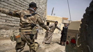 An Iraqi special forces soldier directs a distraught couple to safety as his comrades battle Islamic State militants, in the al-Tanek neighborhood of Mosul, Iraq, Monday, April 24, 2017. (AP / Maya Alleruzzo)